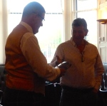 Colin presents the waistcoat to Euan